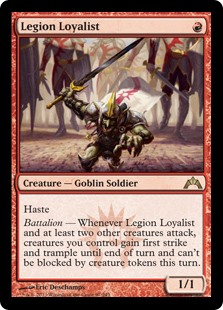 Legion Loyalist  HasteBattalion — Whenever Legion Loyalist and at least two other creatures attack, creatures you control gain first strike and trample until end of turn and can't be blocked by creature tokens this turn.