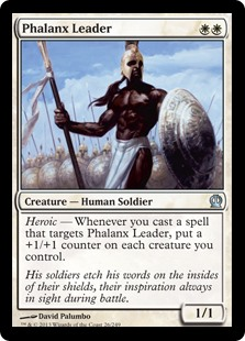 Phalanx Leader  Heroic — Whenever you cast a spell that targets Phalanx Leader, put a +1/+1 counter on each creature you control.